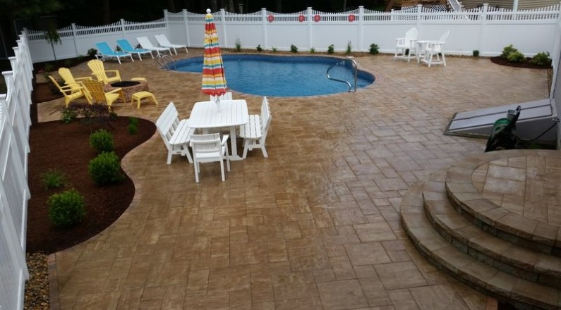 new pool installation with brick paver surround and patio