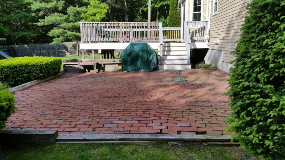 old brick patio before removal for new patio installation
