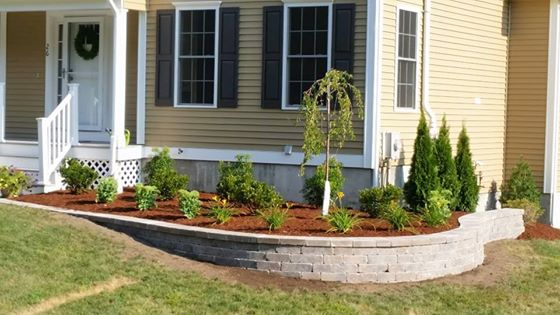 landscaping installation with new shrubbery and mulch