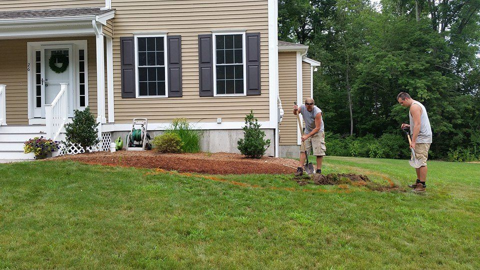two men working on new landscaping project