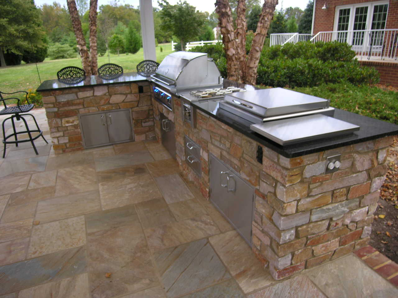outdoor kitchen installation project with stainless steel appliances